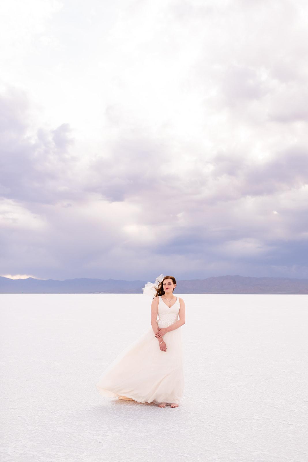 Romantic bridal portrait of Adri at the Bonneville Salt Falts in Utah. Taken by Coley Cook Photography.