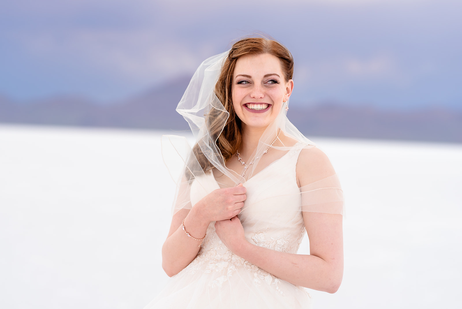Happiest bridal portrait of Adri at the Bonneville Salt Falts in Utah. Embrace the wind! Taken by Coley Cook Photography.