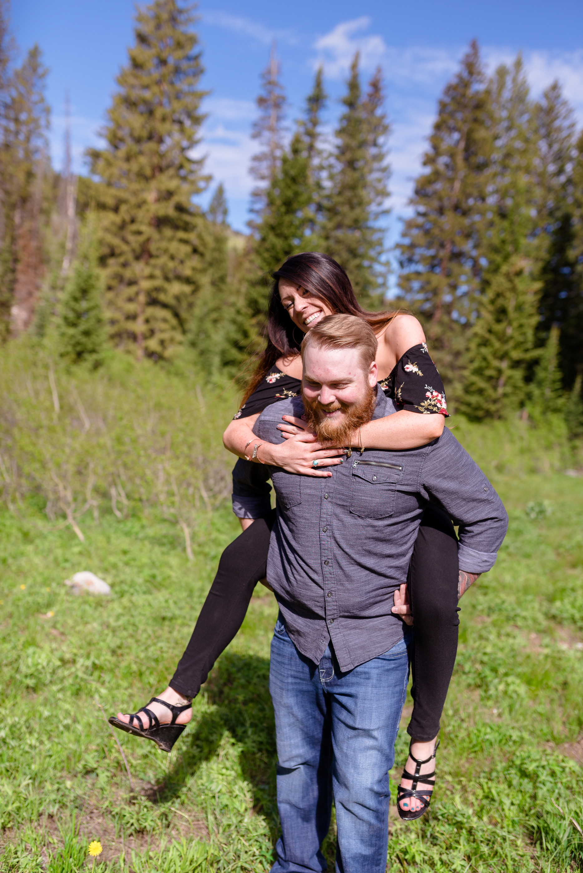 Pig back rides through a sunlit meadow. Morning engagement session in the Salt Lake mountains. Engagement session at Jordan Pines Campground in Big Cottonwood Canyon.