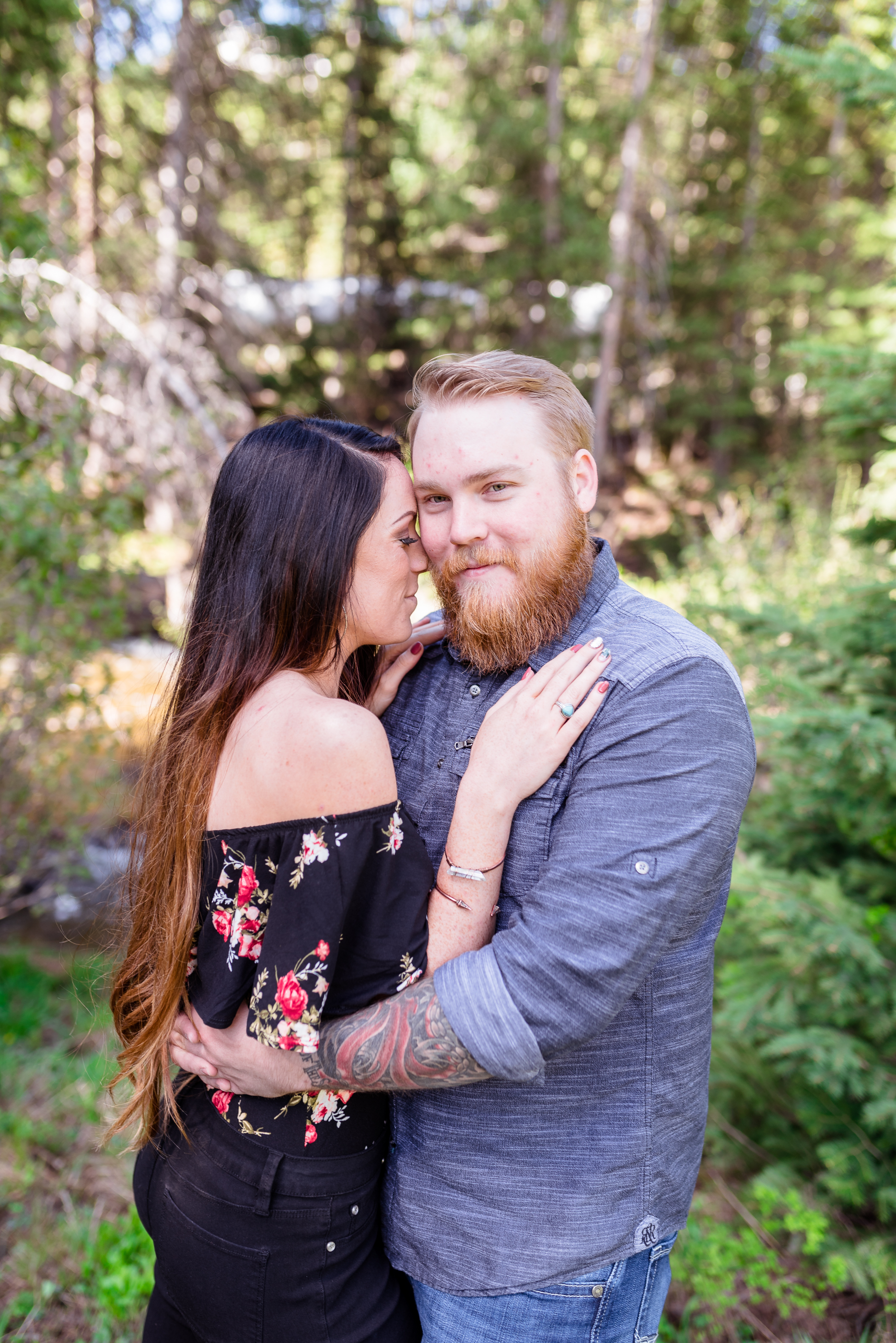 Snuggling her man. Morning engagement session in the Salt Lake mountains. Engagement session at Jordan Pines Campground in Big Cottonwood Canyon.