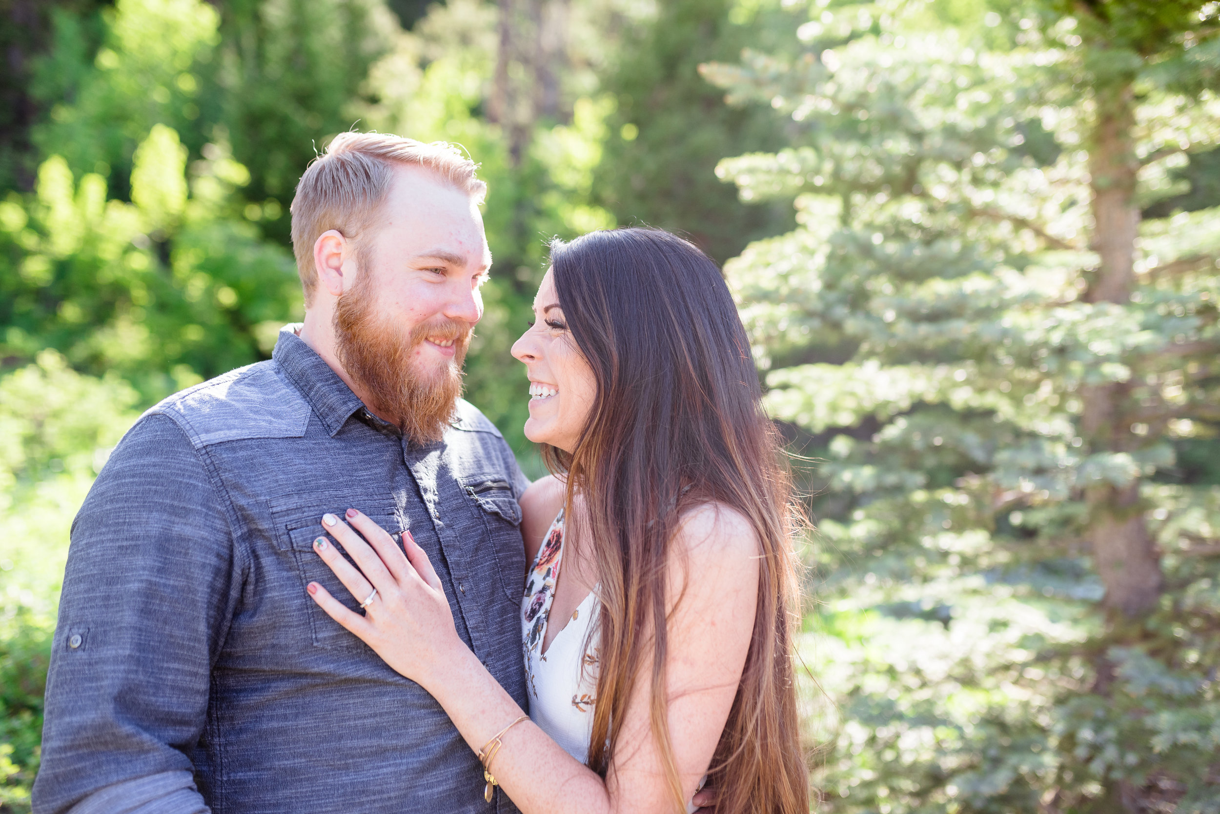 Always laughing together. Never stop laughing with each other. Morning engagement session in the Salt Lake mountains. Engagement session at Jordan Pines Campground in Big Cottonwood Canyon.