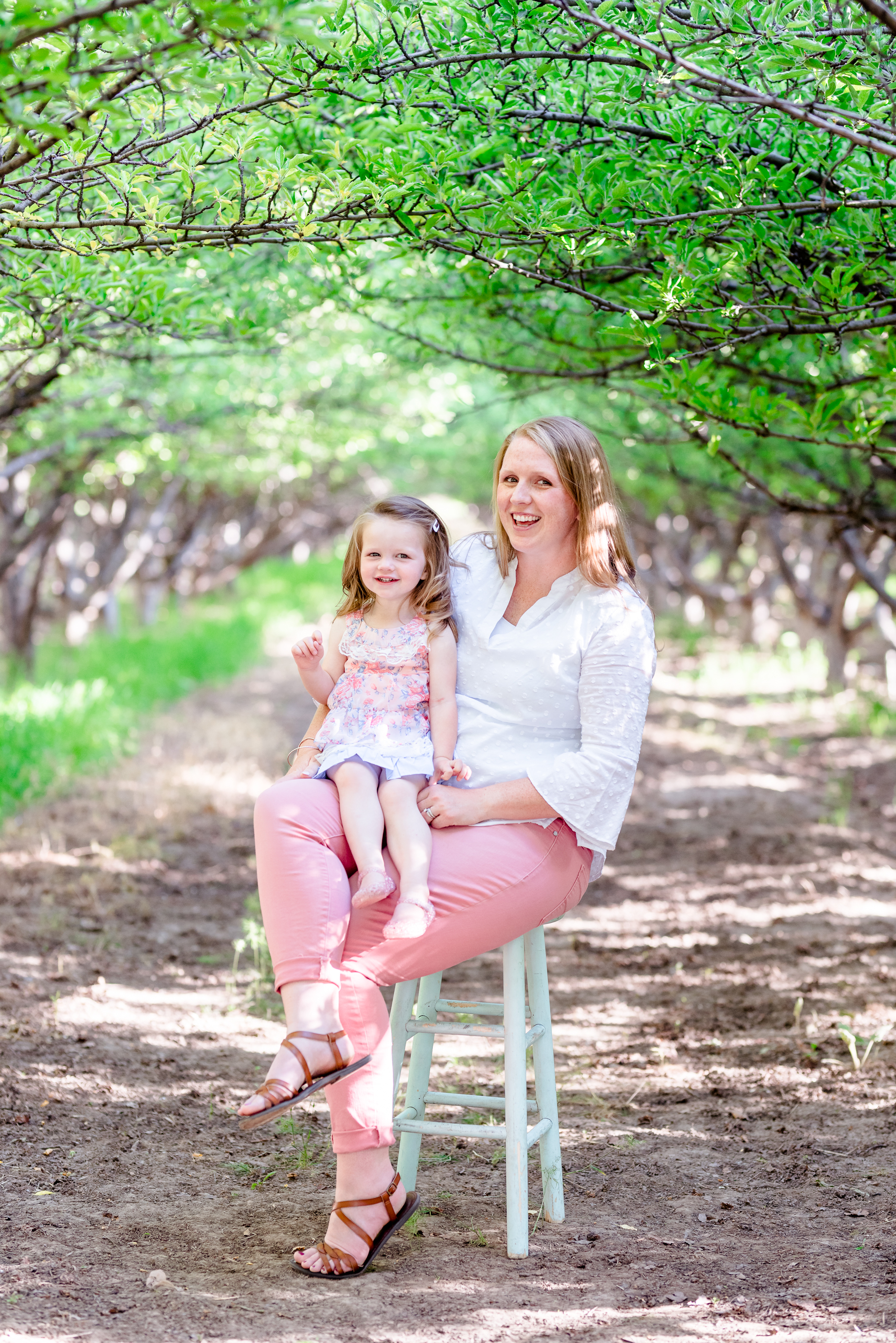 Mother and daughter. Family Session taken at the Provo Orchards in Provo, UT by Coley Cook Photography.