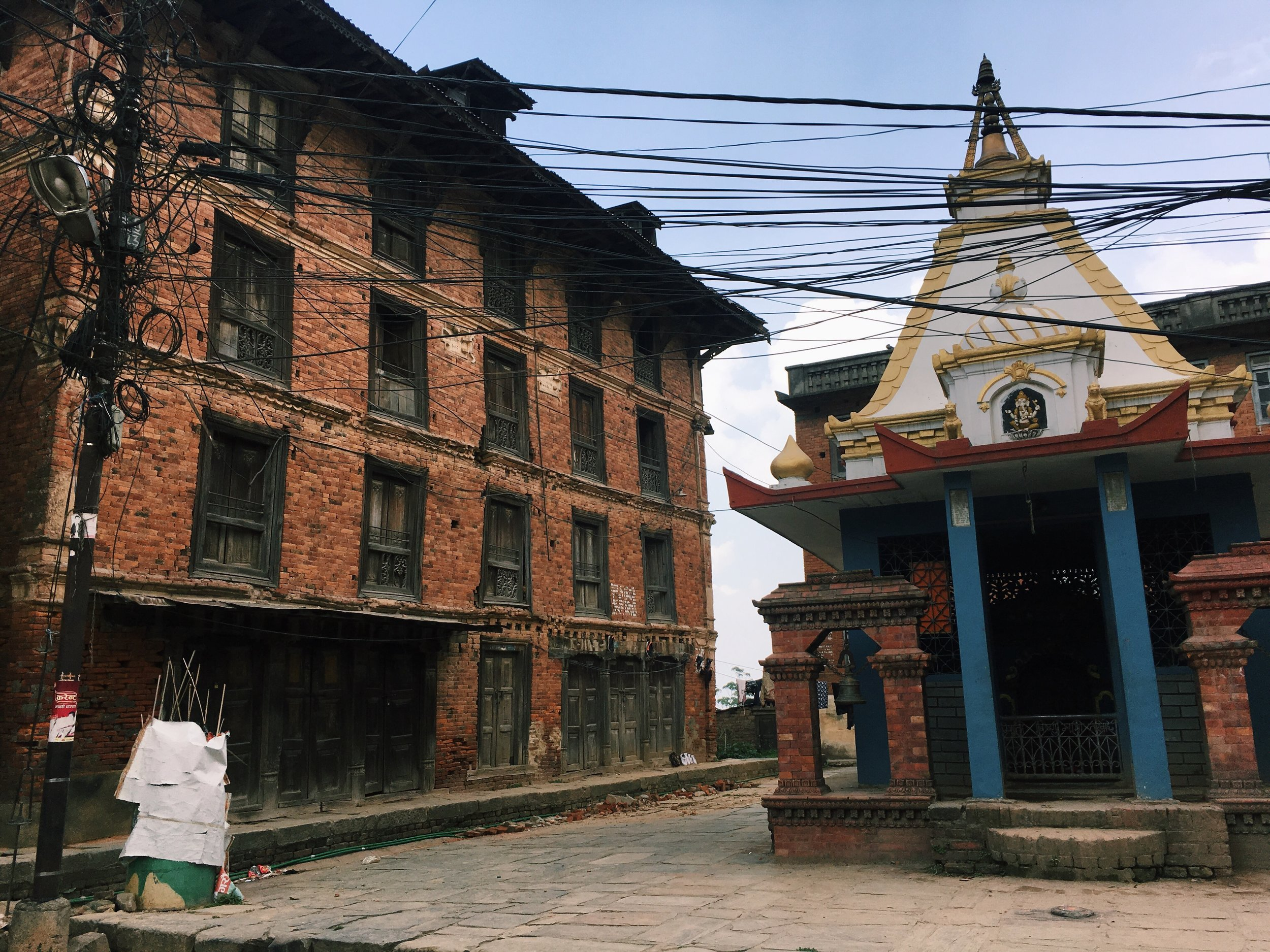 An example of a Newari house (sadly damaged in the Earthquake of 2015), with a small temple outside.