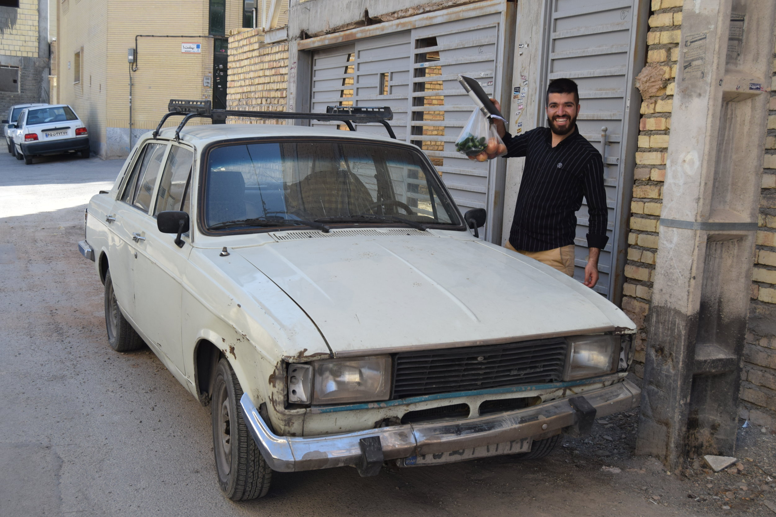 This young man showed me around Isfahan, and brought me home for dinner! He was very proud of his car by the way.