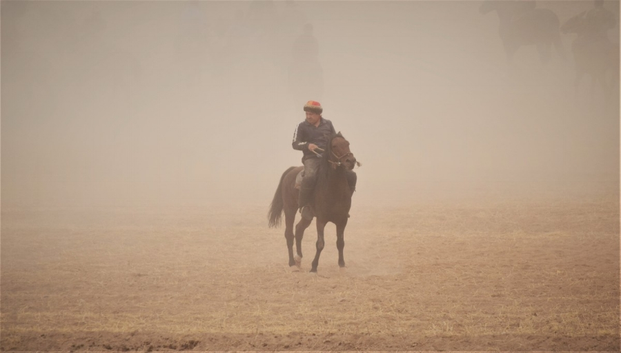 Rider in the outskirts of the massive game of Ulak
