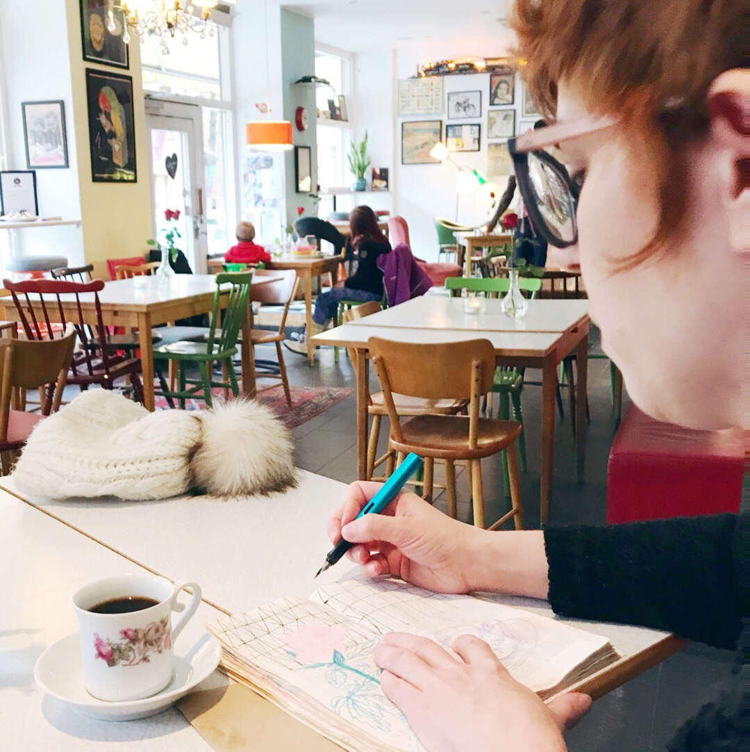 Sketching in my travel journal, in a cozy bar in Stockholm, while having a fika moment!