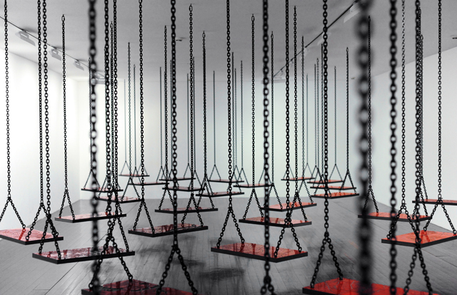 Mona Hatoum, Suspended , 2011. High pressure laminate, metal chains, dimensions variable, Photo: Hugo Glendinning, Courtesy of the Artist and White Cube