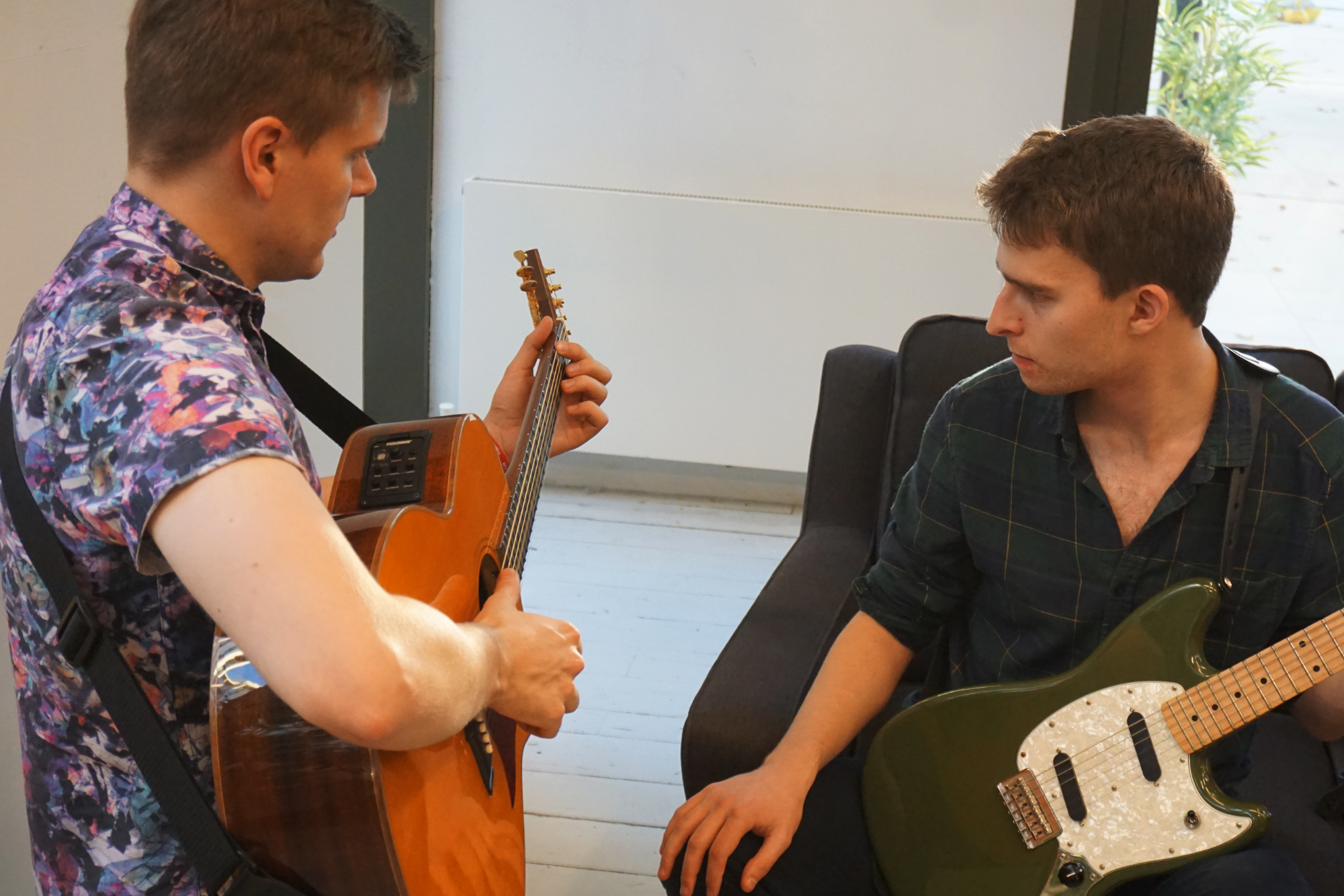 Darryl, teacher - with Rob helping him with his fingerpicking in this photo