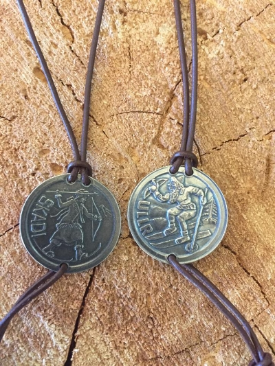 Ullr and Skadi medals are available for purchase throughout the year at Ph.D. Skis.