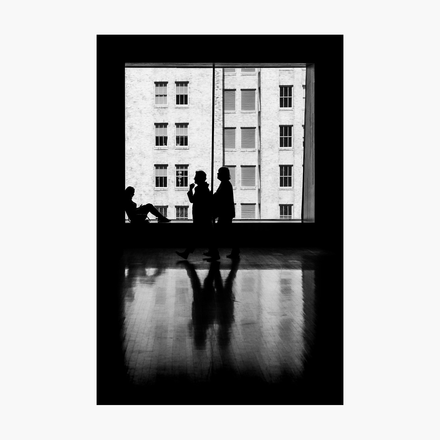 @harrywedmonds  San Francisco, California, USA September 2017  My creative background is in the London design and advertising industry, where I also work as a design and art director. The graphic motifs in my photography are no doubt a direct result of my experience; I'm often drawn to silhouettes, shadows, and and striking architectural spaces.  I took this photograph in an art gallery in San Francisco, where the vast windows became a canvas upon which to capture passing visitors.  Photographed with the  FujiFilm X-T2  and  XF56 F1.2 .