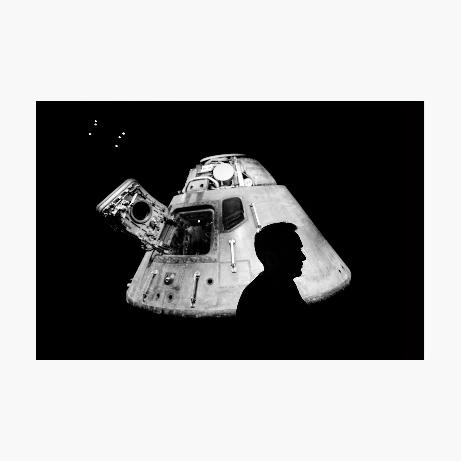 @harrywedmonds  Cape Canaveral, Florida, USA June 2017  I've always been captivated by science and science fiction so a visit to Florida's space coast was a real highlight for me. I knew exactly what I wanted when I saw the Apollo 14 Command Module, although getting it wasn't easy. But that's the buzz of street photography.  What I love about this image is the feel of an era. The film grain, the soft focus of the background, and the tones of grey evoke 1960s space exploration. Juxtaposed against that crisp (candid) silhouette. The artificial lights hanging above like a distant constellation are perhaps my favourite detail.  Photographed using the  FujiFilm X-T2  and the  XF16 F1.4 WR .