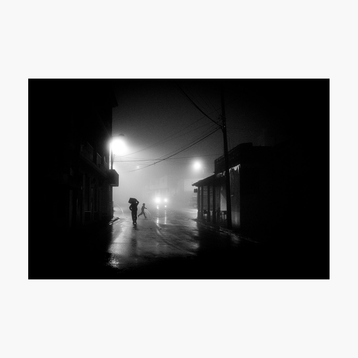 @harrywedmonds  Chugchilán, Ecuador, South America January 2018  The last in my selection was captured after a very long day hiking the Quilotoa Loop. In the pouring rain. All I really wanted was a hot shower, a plate of food, and some much needed sleep. But the fog shrouding the town of Chugchilán was too enticing.  Although ominous in tone, the child in full sprint with both feet off the ground brings a wonderful touch of joy to this photograph. There's also a third figure to be found in the scene, lurking in the shadows.  Photographed using the  FujiFilm X-T2  and the  XF35 F2 WR .