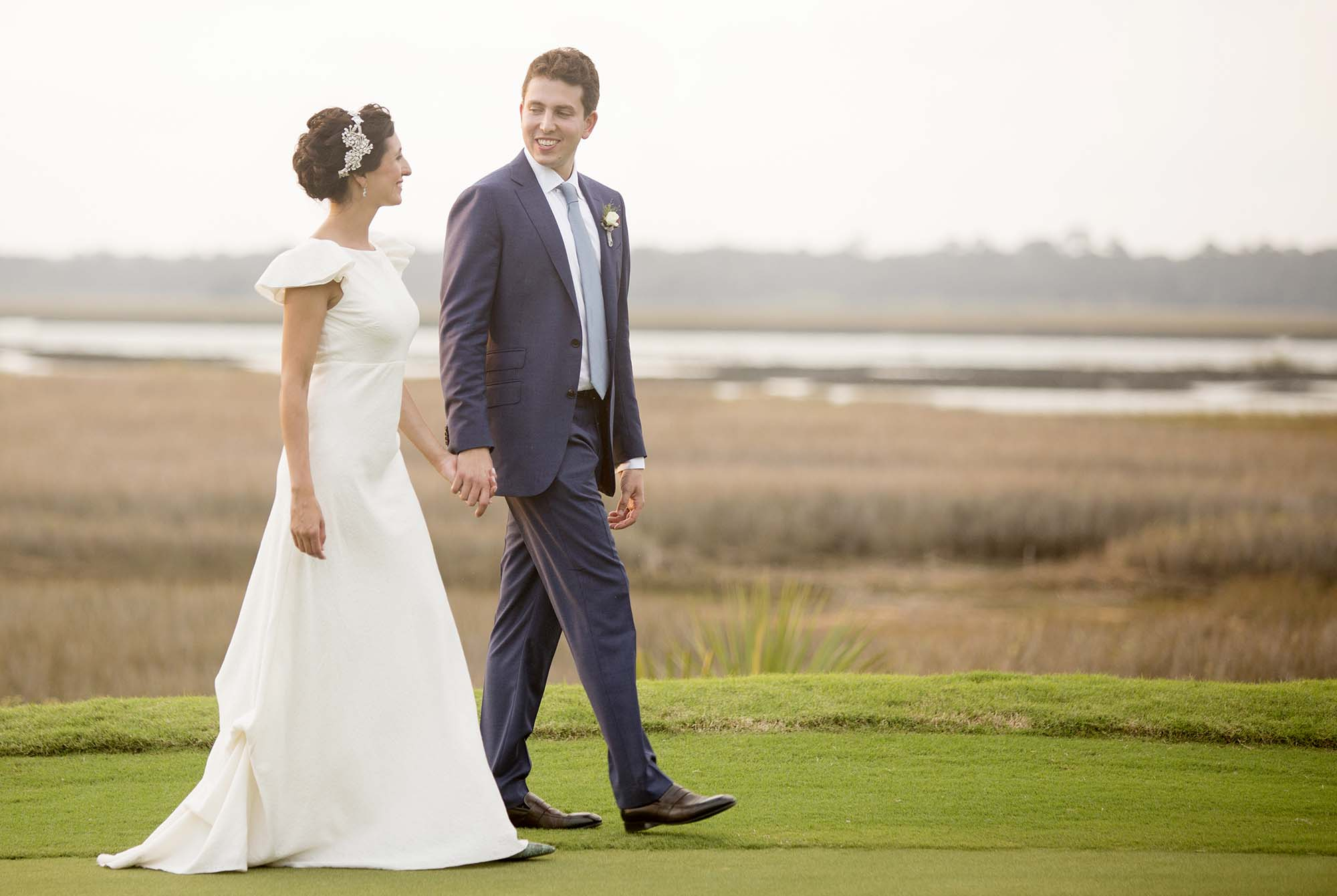 Bride and Groom walking at the River Course on Kiawah Island.