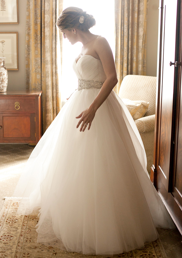 A bride getting ready for her wedding in a Charleston hotel room.