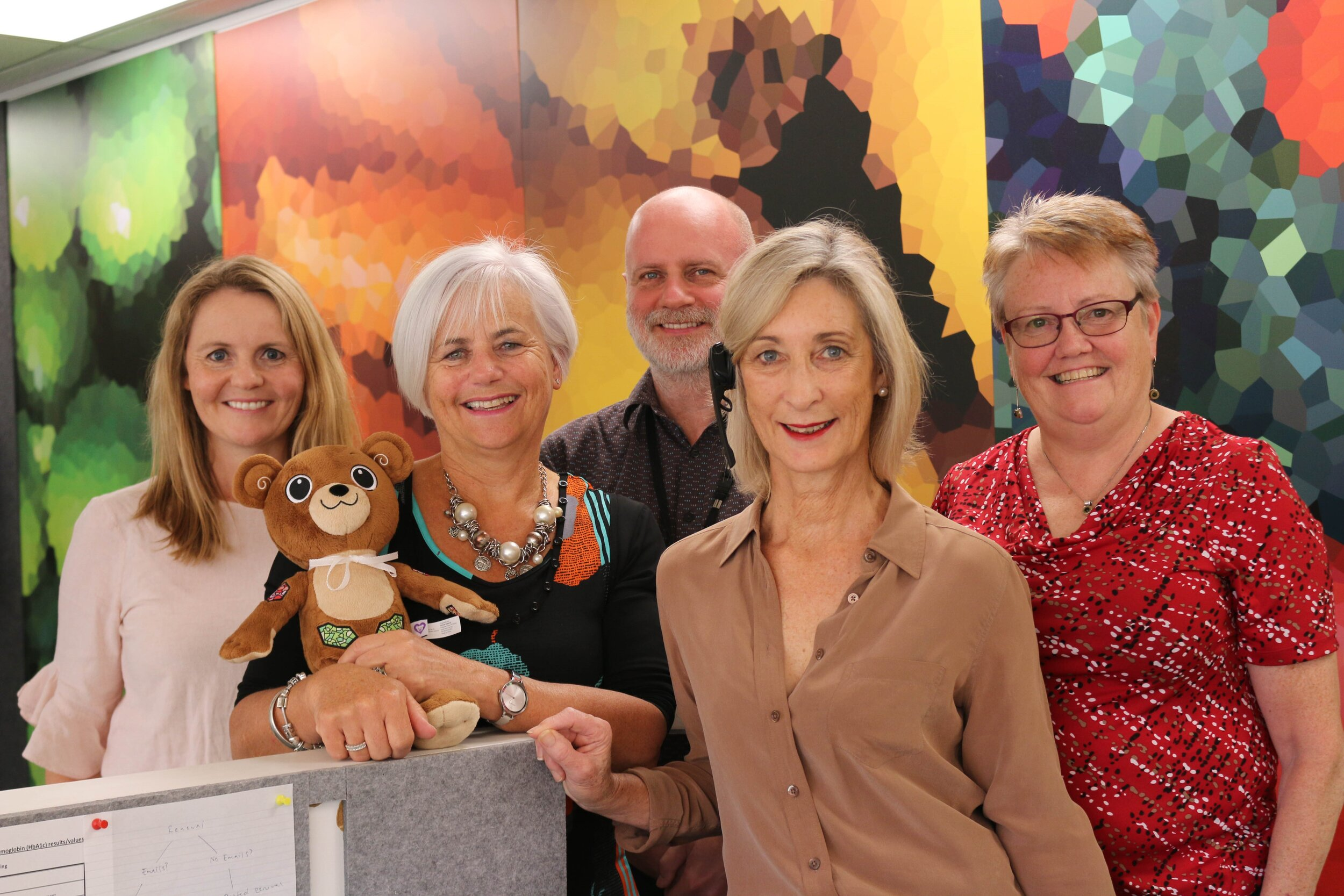 Some of the team at the Diabetes NZ office: (from left) Marsha Mackie, Heather Verry with Jerry the Bear, Stephen Jarvis, Nicky Steel and Liz Dutton