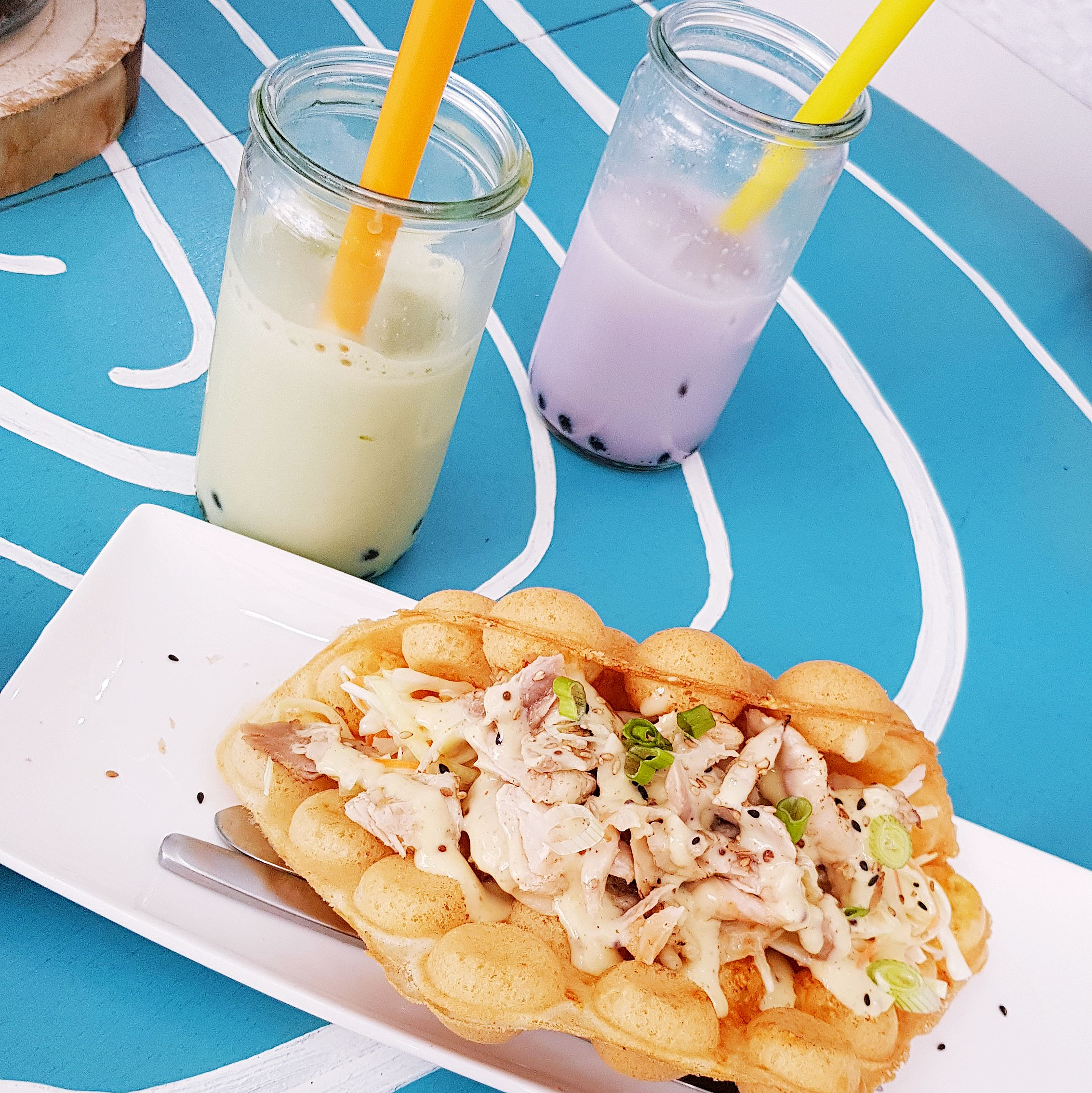 Foo Concepts Rotterdam Restaurant Netherlands dijon chicken egg puff egg waffle with bubble milk tea latte