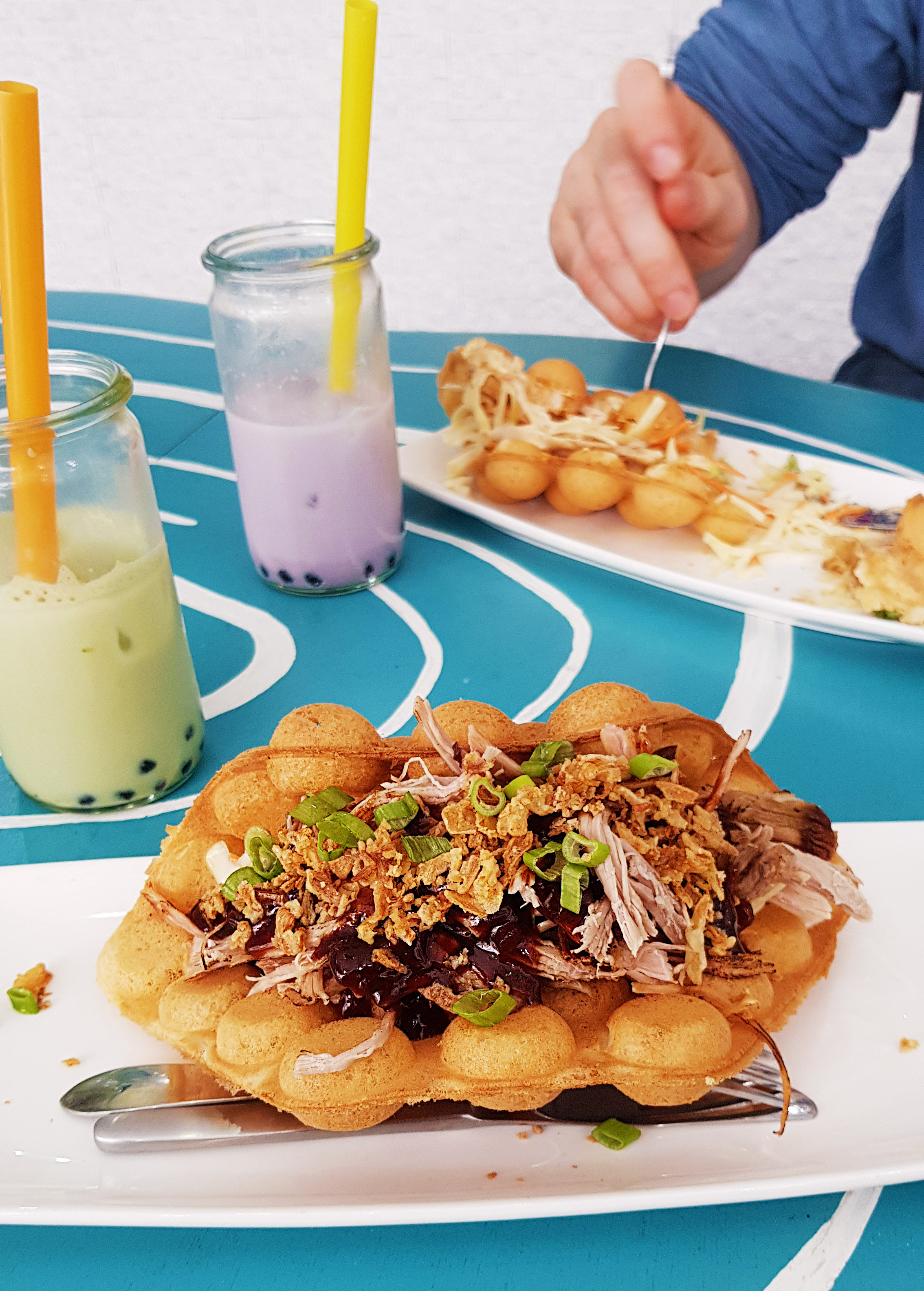 Foo Concepts Rotterdam Restaurant Netherlands pulled pork egg puff egg waffle with bubble tea latte places to eat