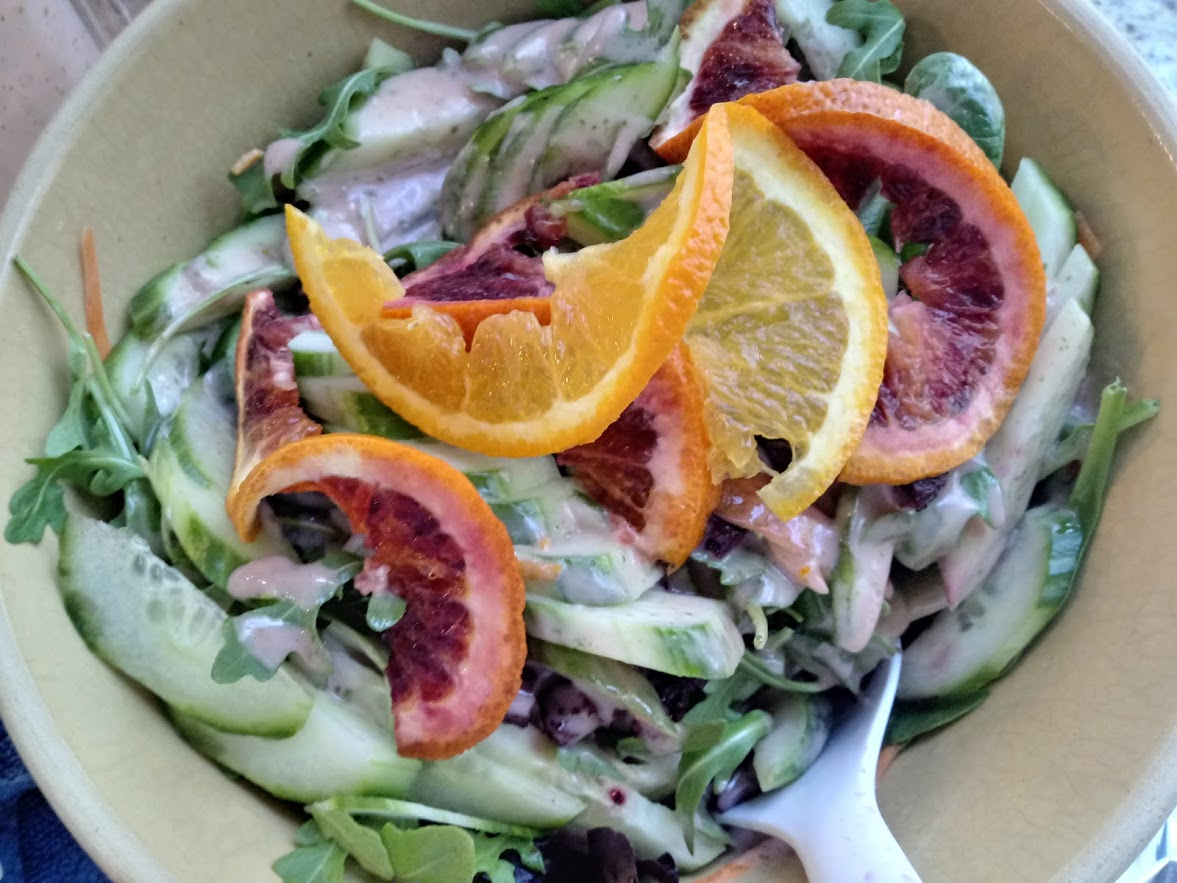 Composed organic and local salad layered with roasted, seasoned beets; seedless cucumbers and more… with scratch-made blood orange - citrus basil vinaigrette.