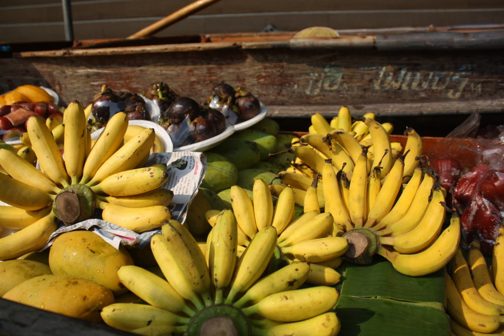 Bunches of bananas and mangosteen
