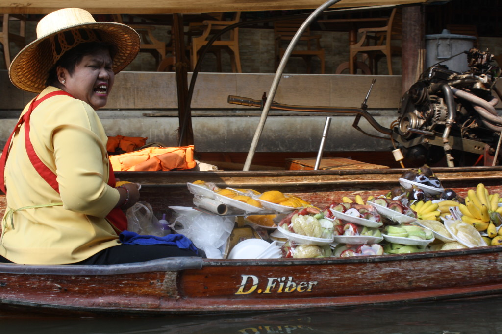 Thai woman selling fruit at the floating market