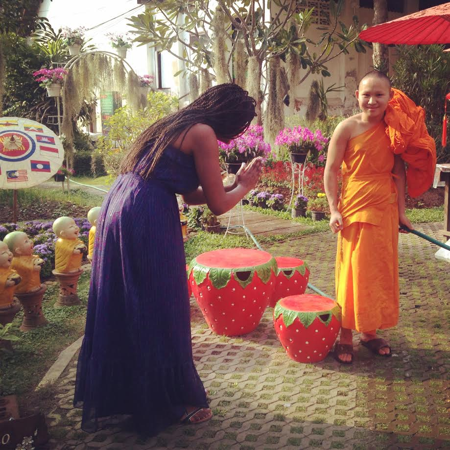 """I chatted with a """"novice""""--a 17-year-old monk-in-training.  I gave the official Thai greeting, the Wai, as a sign of respect."""