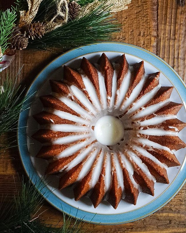 Lemon Pound Cake with Lemon Glaze// Baking pound cakes in a bundt pan is a great way to turn a boring loaf cake into a festive beaut!  My sister asked me to bake her a lemon pound cake, so I did as part of my family's early Christmas celebration. I can't say enough about how unbelievably lemony and delicious this cake was!  #holidaybaking