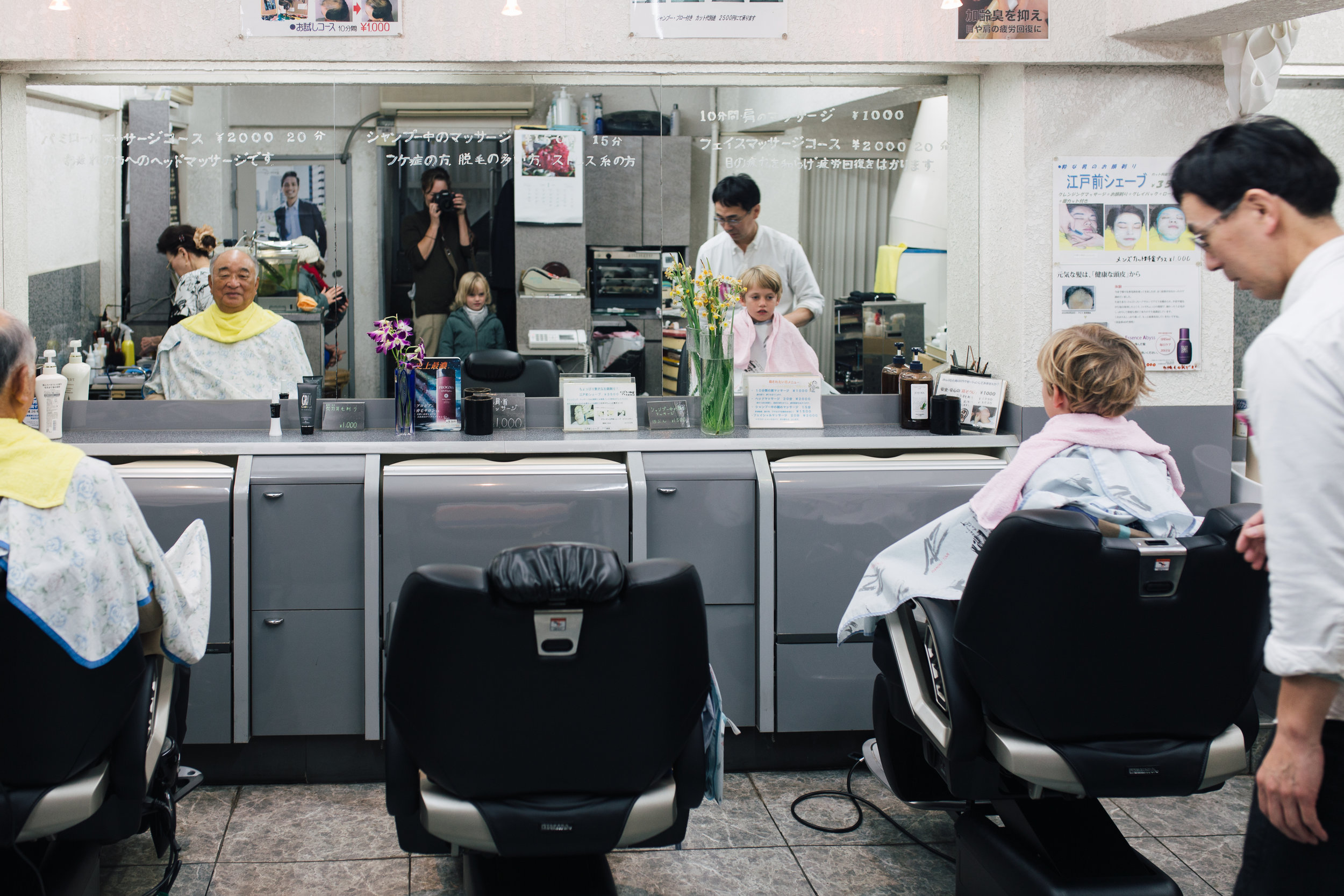 Tom, our sacrificial lamb, at the barbershop in Tokyo