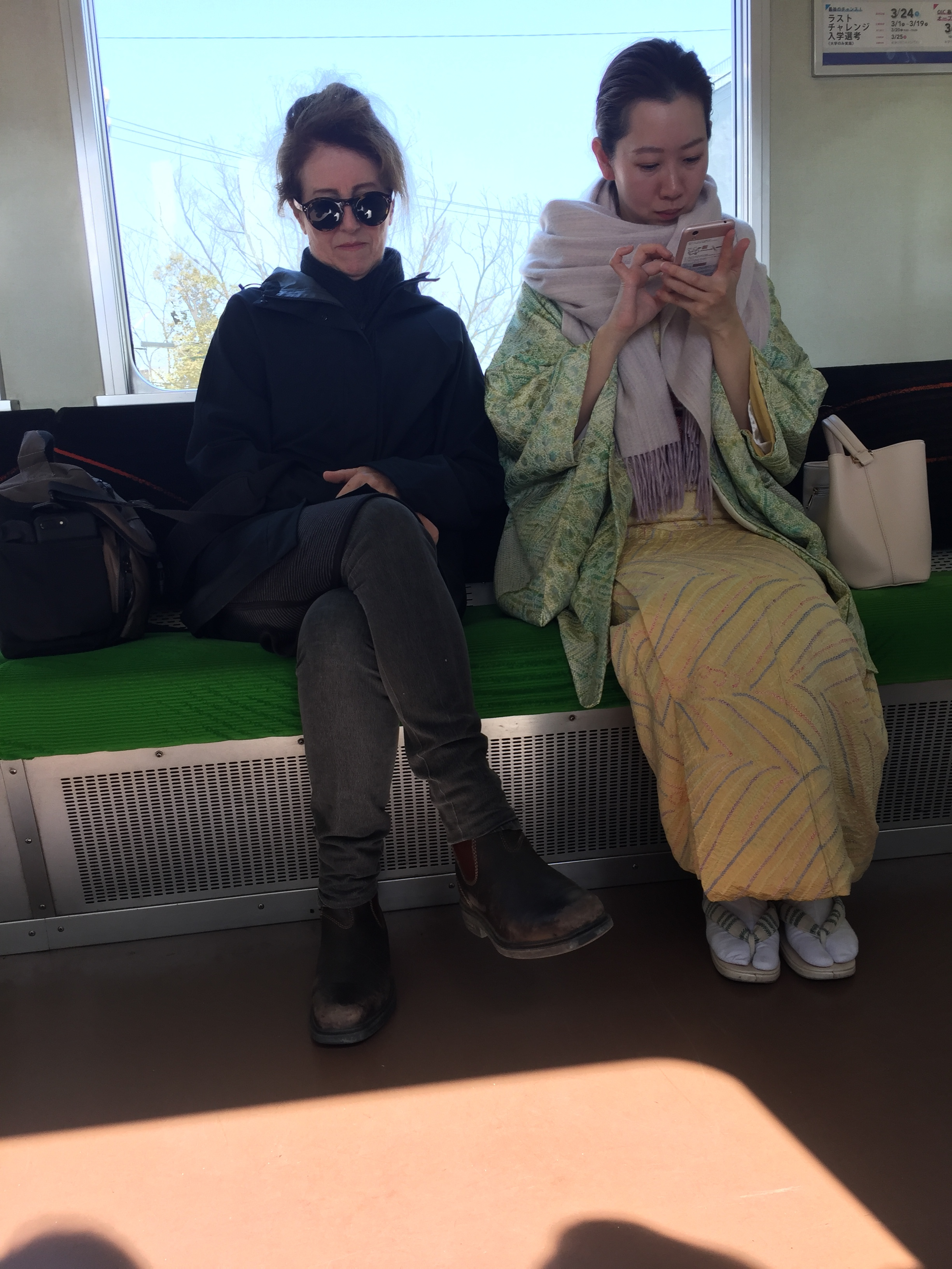 All this while Gillian is travelling through the Japanese countryside, looking CHIC AS next to her new friend.