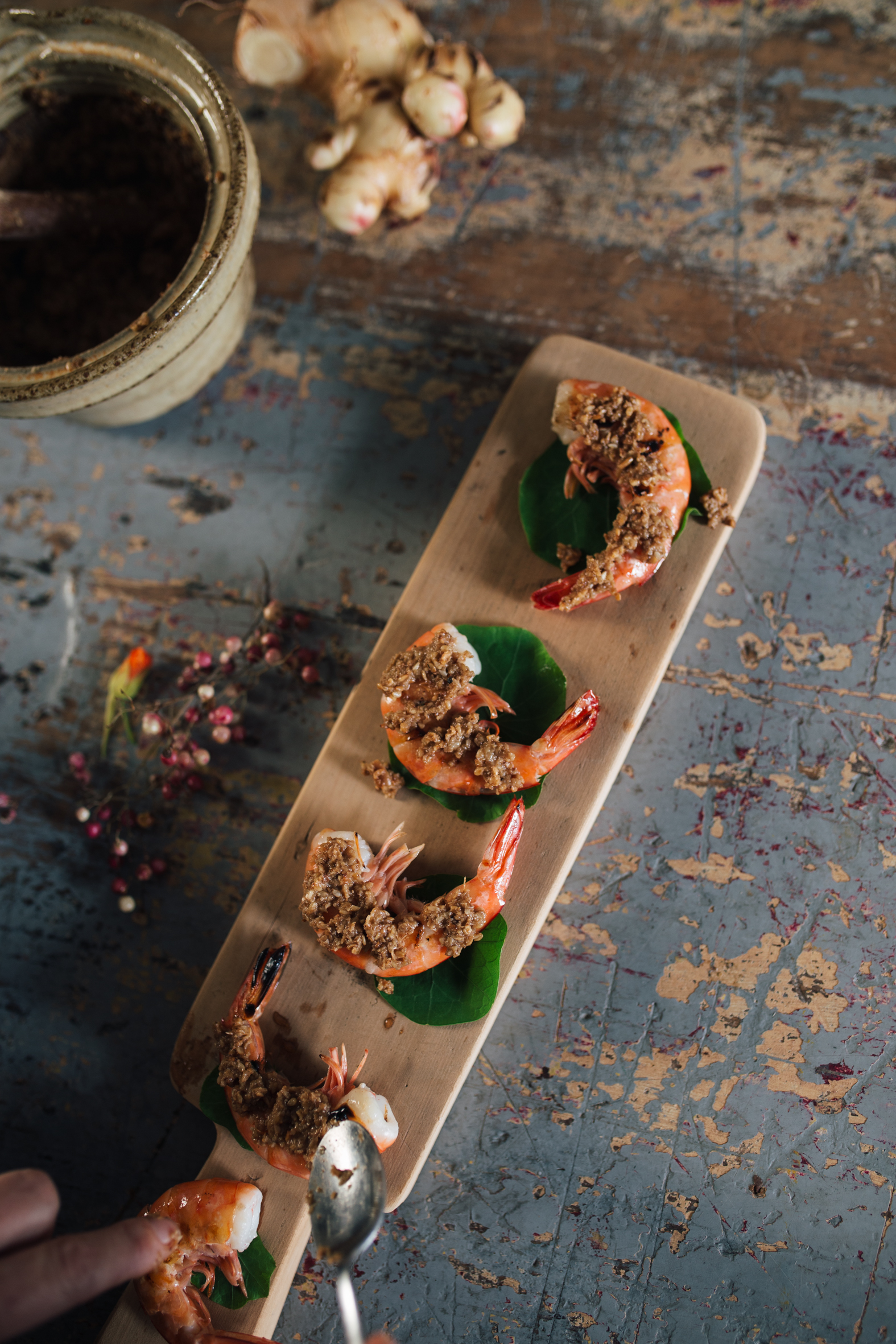 Serve the miso paste on top of char grilled prawns, wrapped in nasturtium leaves