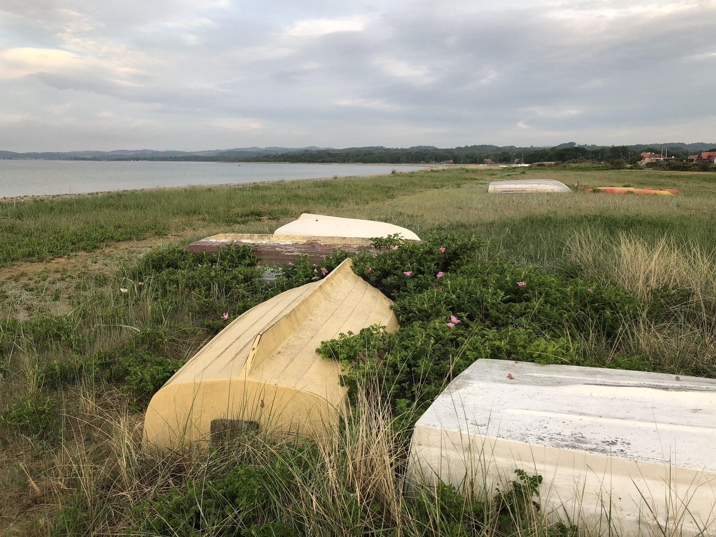 Upturned dingies above the high tide mark. Ebeltoft, Denmark.