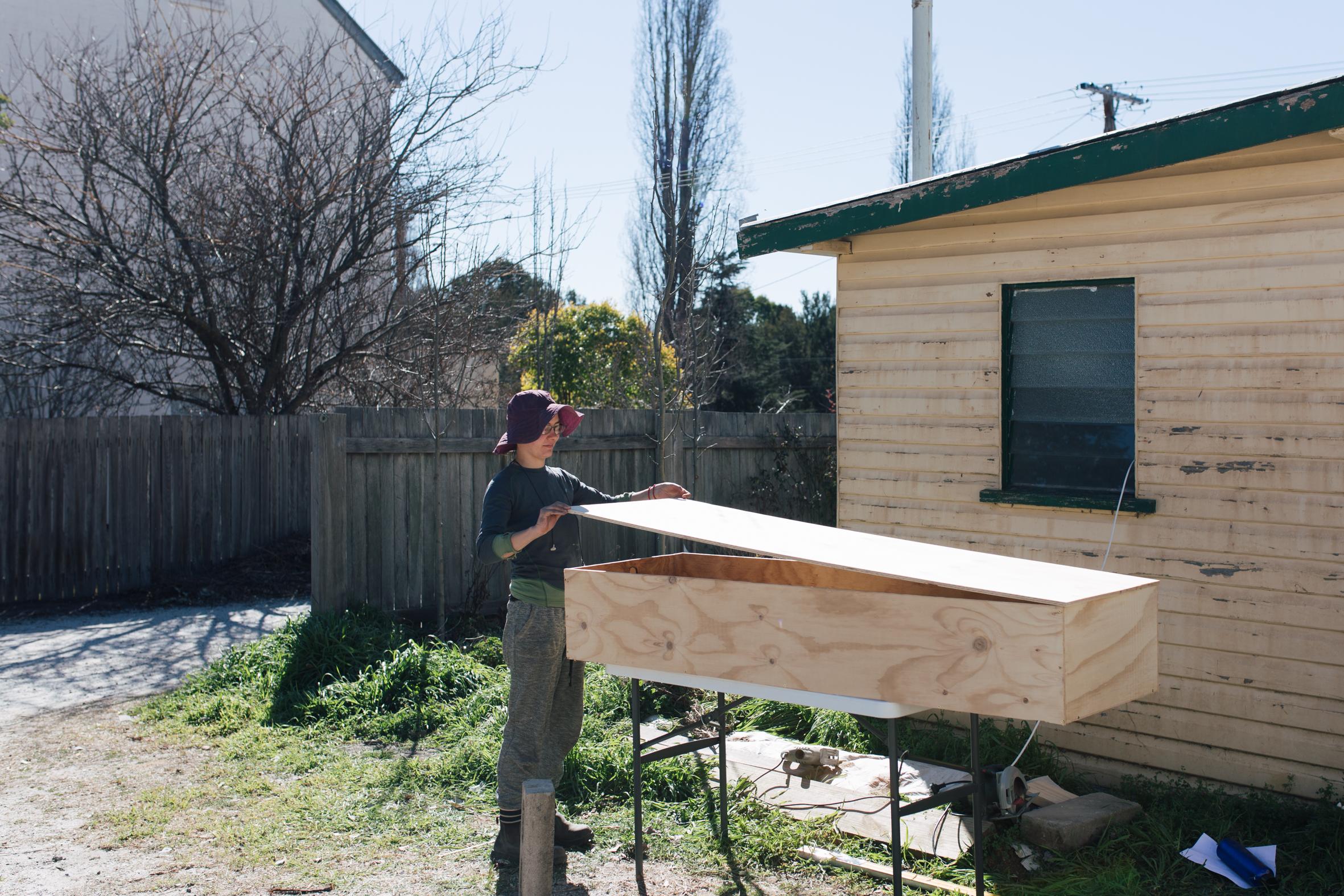 Iris making the plywood coffin