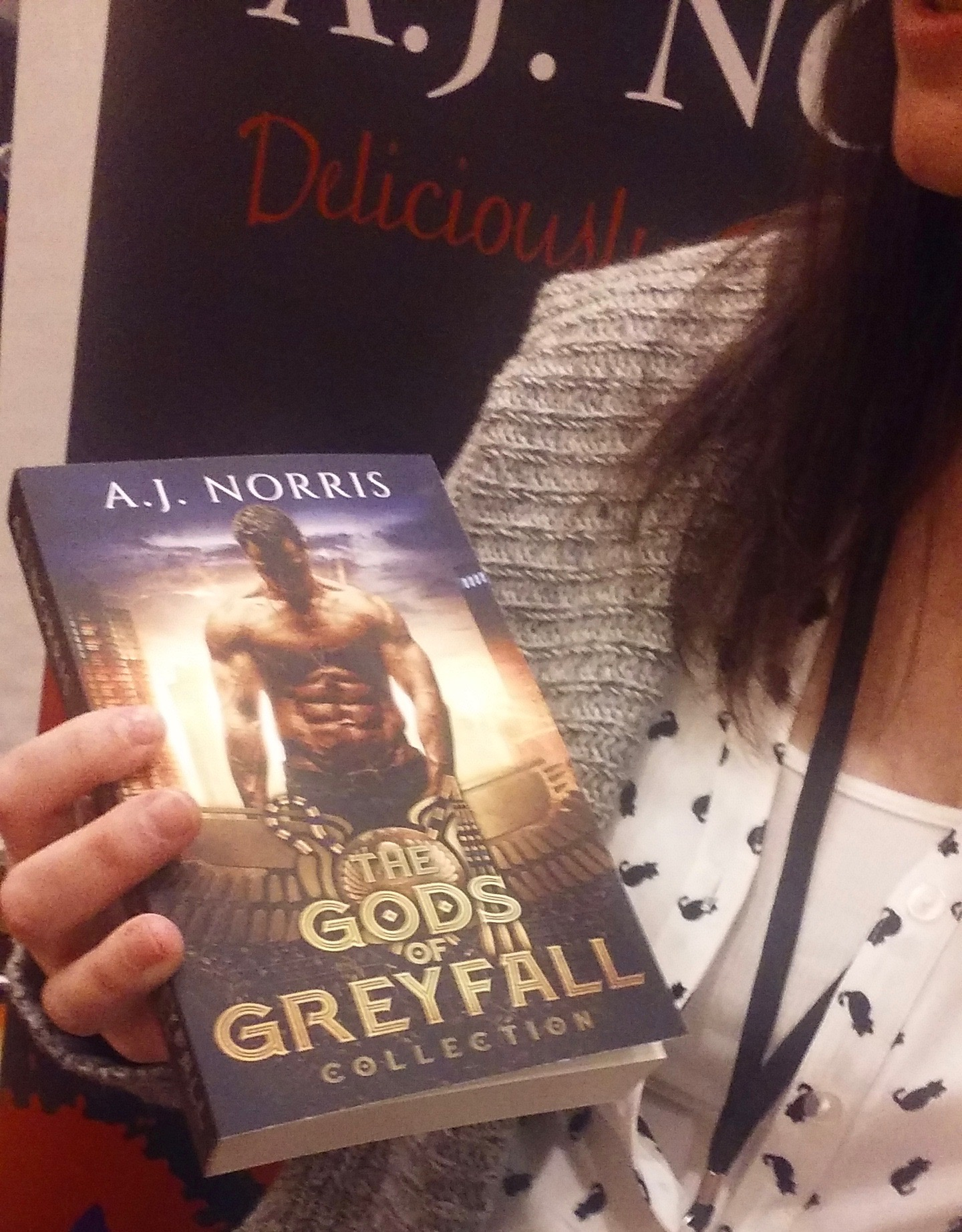 A.J. Norris holds a copy of her newly released The Gods of Greyfall Collection at the 2018 Books in Bourbon Country Author Signing Event in Louisville, Kentucky on March 31st. Check her out on  Goodreads,  too