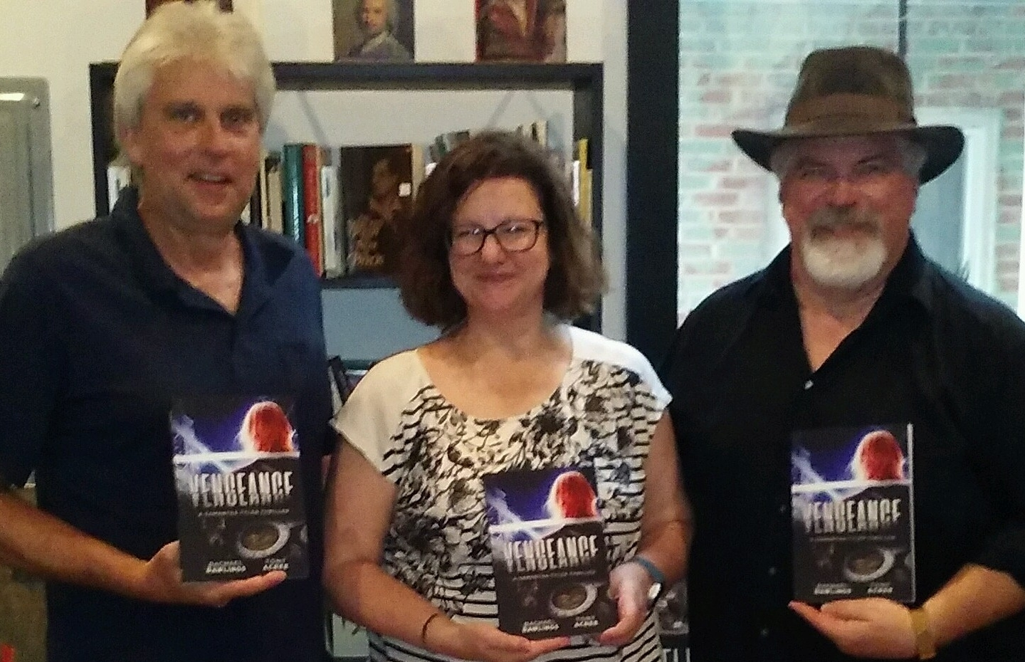 Authors Rachael Rawlings and Tony Acree launched their collaboration,   Vengeance: A Samantha Tyler Thriller  , at Nanny Goat Books in Louisville on June 8. Pictured are (l-r) Robb Hoff, Rawlings, and Acree