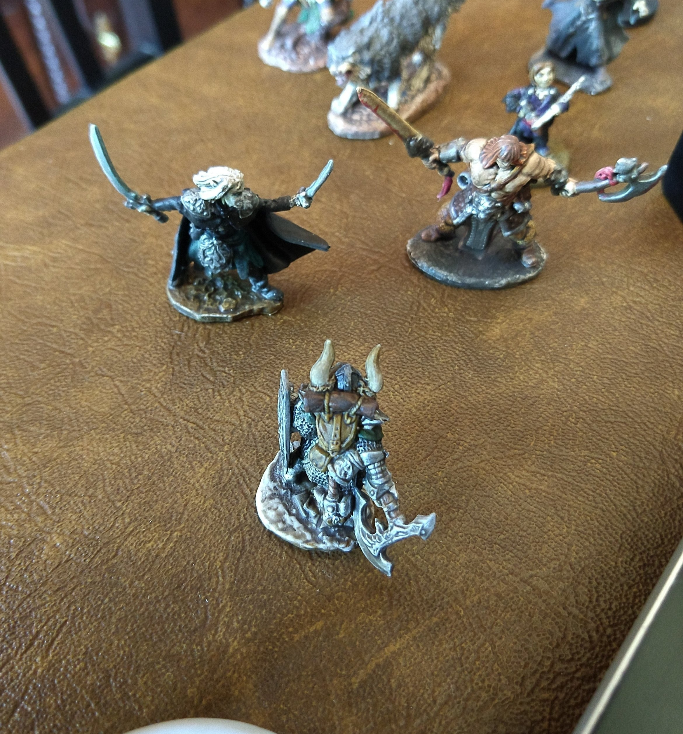 Miniatures after clear coating look at the detail from ton the chainmail and axe from the Army Painter dip.