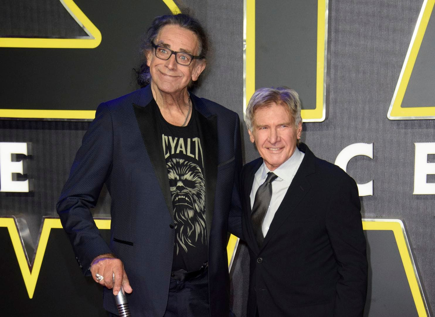 Peter Mayhew with long time onscreen partner Harrison Ford.