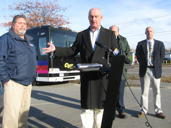 PHOTO BY ROBERT LOWELL. An alliance of private bus lines Tuesday protested METRO's agreement with the University of Southern Maine to shuttle students to Gorham. Pictured, from left, are Gregg Isherwood of Custom Coach and Limousine in Gorham, bus operators alliance spokesman Mark Robinson, Jason Briggs of VIP Tour & Charter Bus Co. in Portland, and Rick Soules, general manager of Cyr Bus Lines in Old Town.
