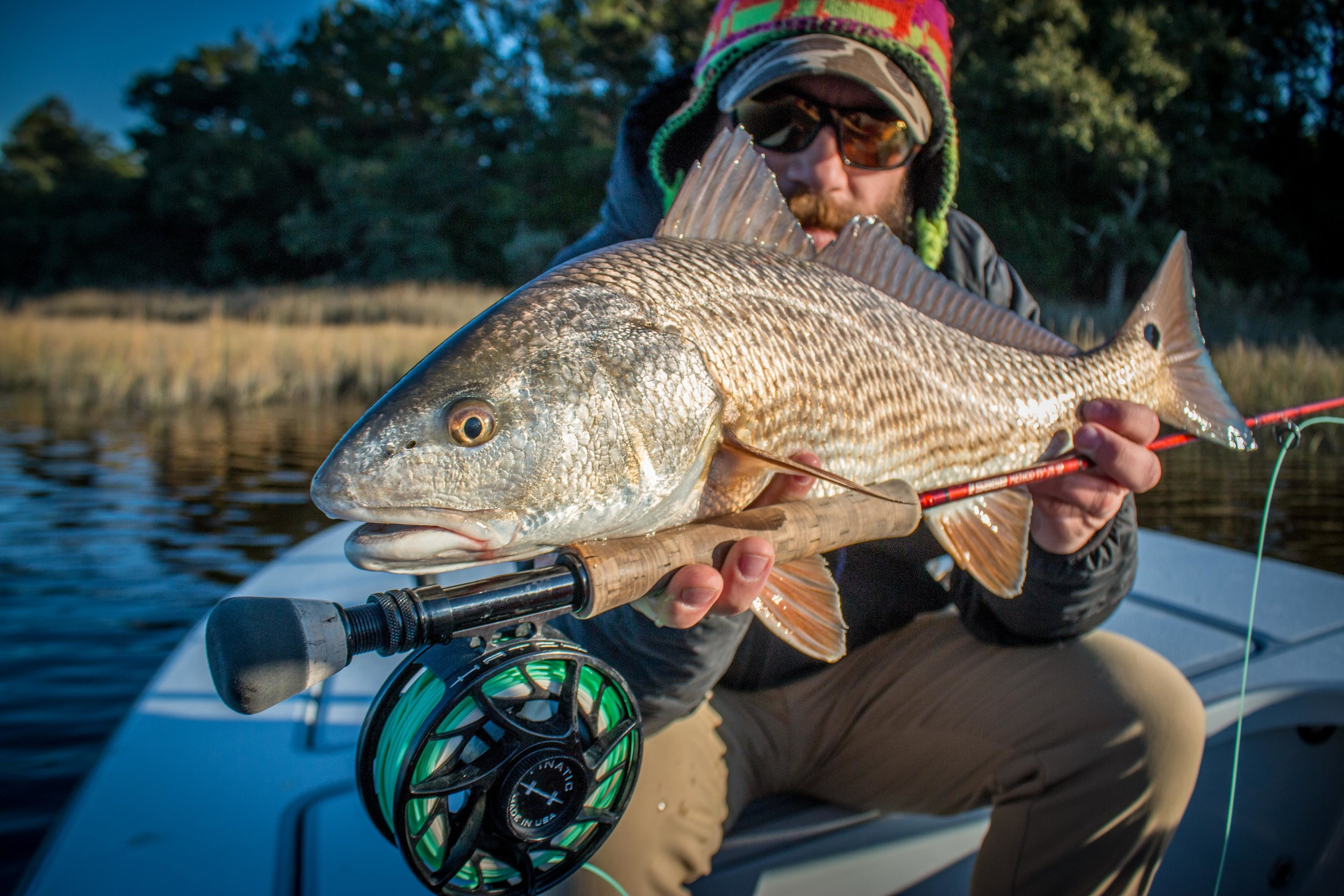 Dallas Thomas with a healthy redfish on one of his signature patterns, the Dr. Dre Two Fey