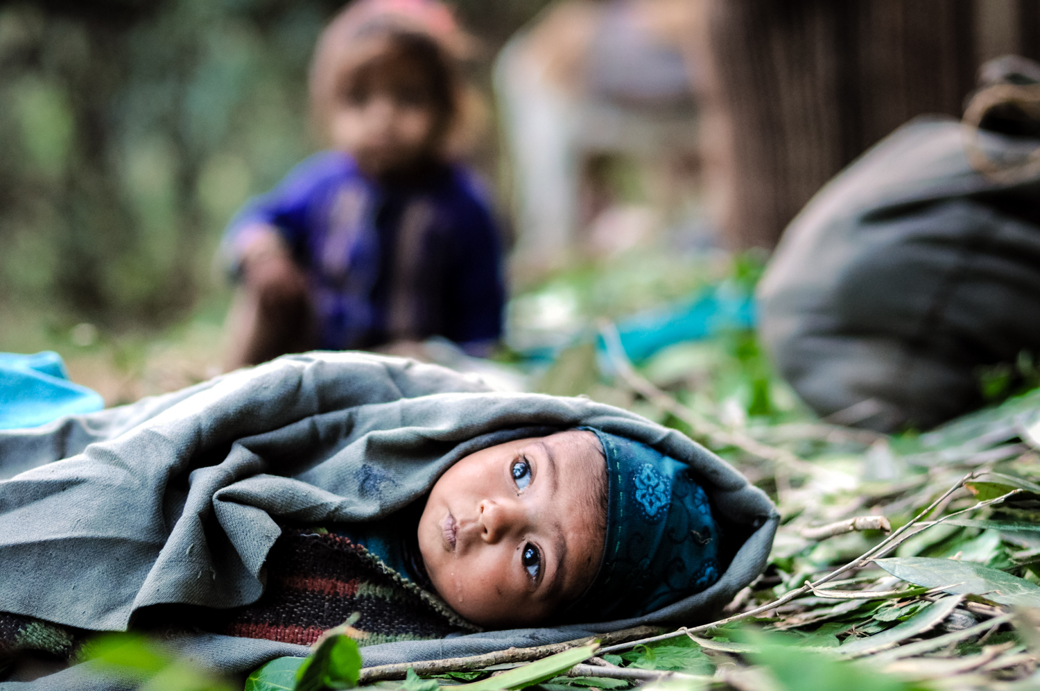 Most Van Gujjars think of themselves as part of the forest; they belong to it, and in it. Here, 3-month-old Halima rests on the forest floor while her parents are busy loading up the pack animals.