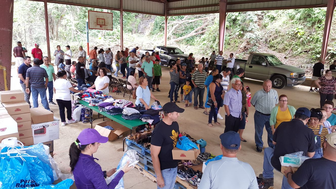 Health and services fair in Yauco on 4 Feb 2018. Patrons received healthcare services (transportation is very challenging in this remote region [note the fallen trees behind the facility]), solar lanterns, hair cuts, food, clothing, and bottled water (more water filters are needed). A Chicago-based March 2018 fundraiser raised money for more water filters, solar lanterns, antibiotics, and over the counter medications.