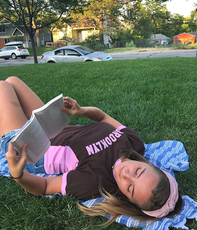 """A resident of Boulder, Hadley Thomas is spending the summer at home. But she still says, """"#BooksTakeMe to a peaceful afternoon in the yard after work."""" What book do you reach for to unwind after a long day? #promotingliteracy #5050books #bookstagram"""