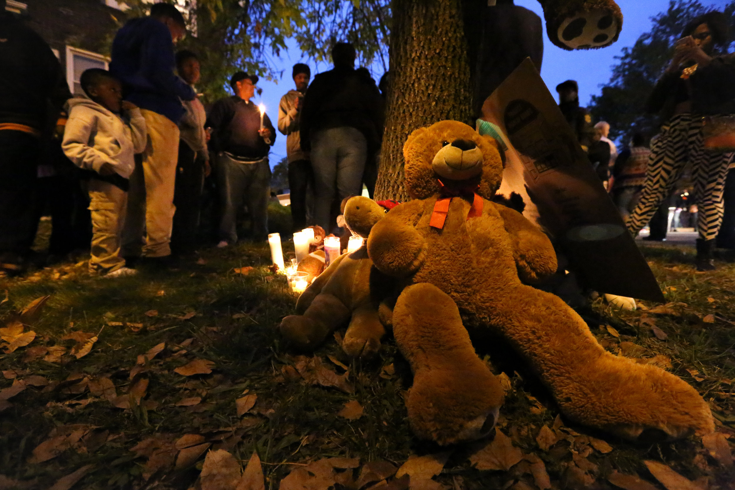 A memorial is formed in the front yard of 18-year-old Vonderrit Myers Jr., killed by an off-duty St. Louis police officer on October 8, 2014, just months after the killing of Michael Brown in Ferguson, MO.