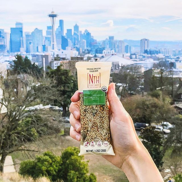 Take our wholesome organic amaranth bars with you wherever you go to stay full and fueled. 🏙 . . . . #nthdegreesnacks #nextlevelsnacking #spaceneedle #seattleskyline #matcha #healthybars #snacking #onthego #amaranth #eatgreen #plantbased #superfood #healthyliving #chooselovely #livethelittlethings