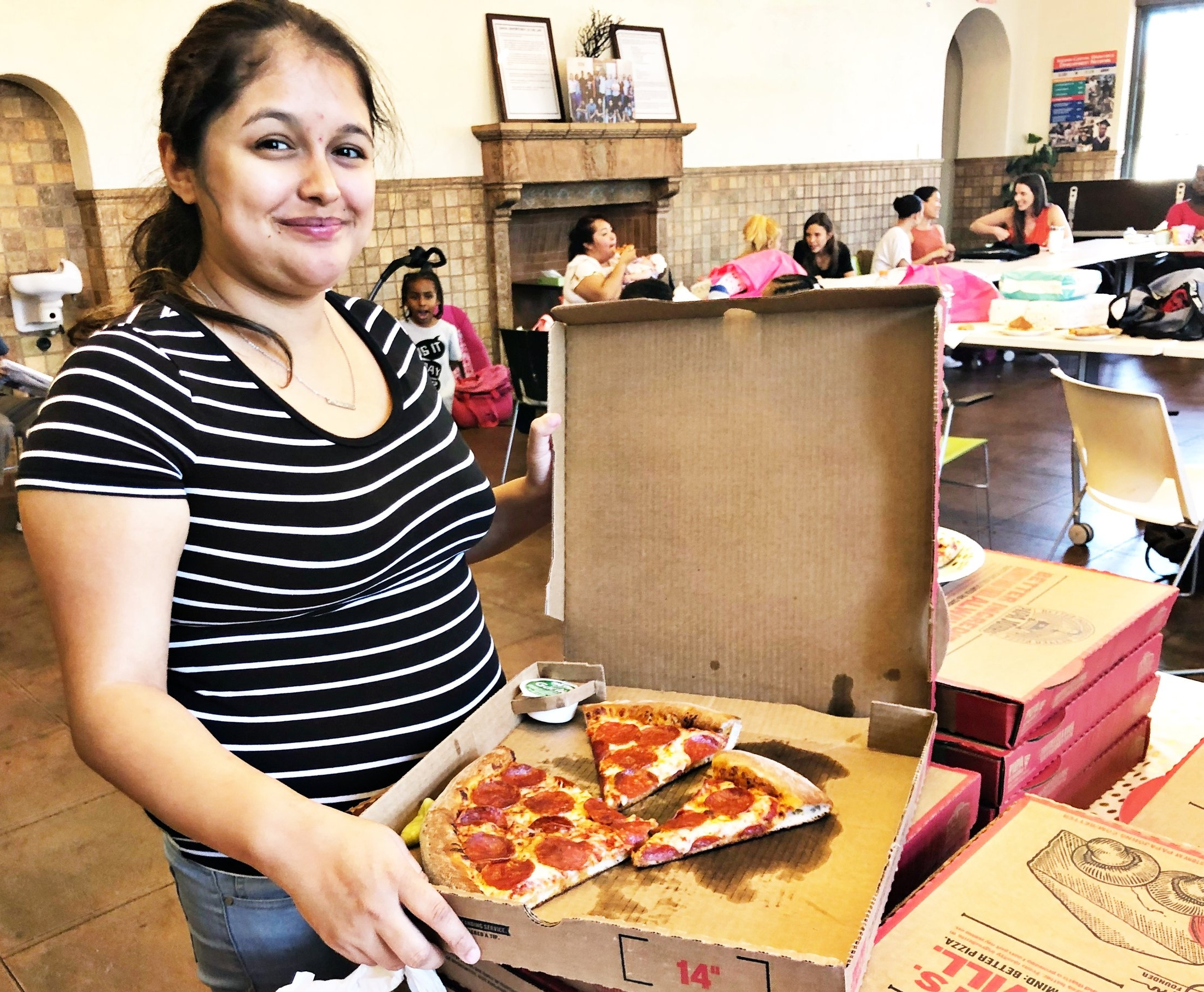 GenerationHer Member Tiffany Lopez enjoys Papa John's Pizza during the organization's bi-monthly meeting in Los Angeles on June, 2, 2018.