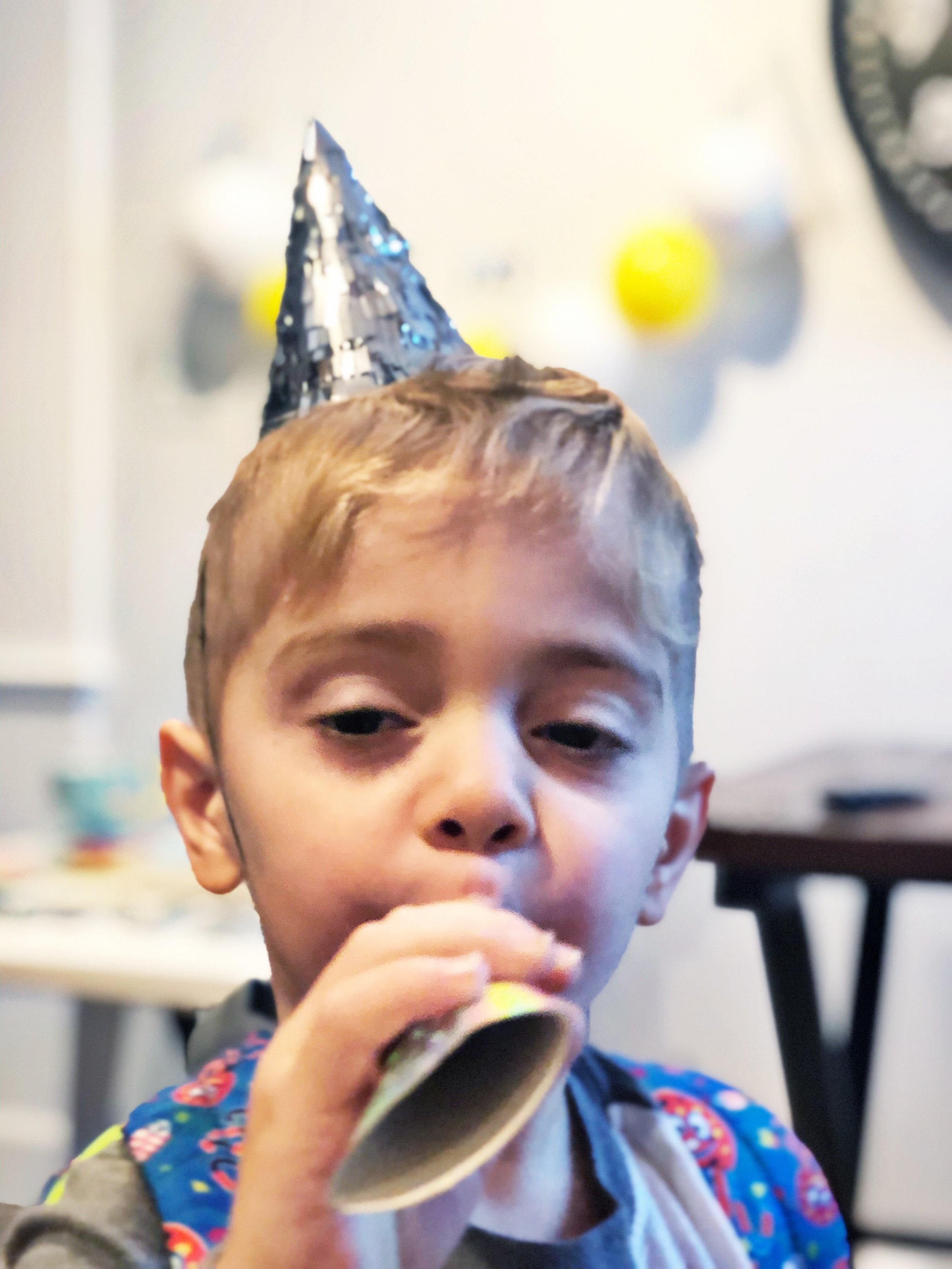 Toby wasn't sure how to use the party blow horn during Benny's birthday breakfast, which made us laugh…A LOT!