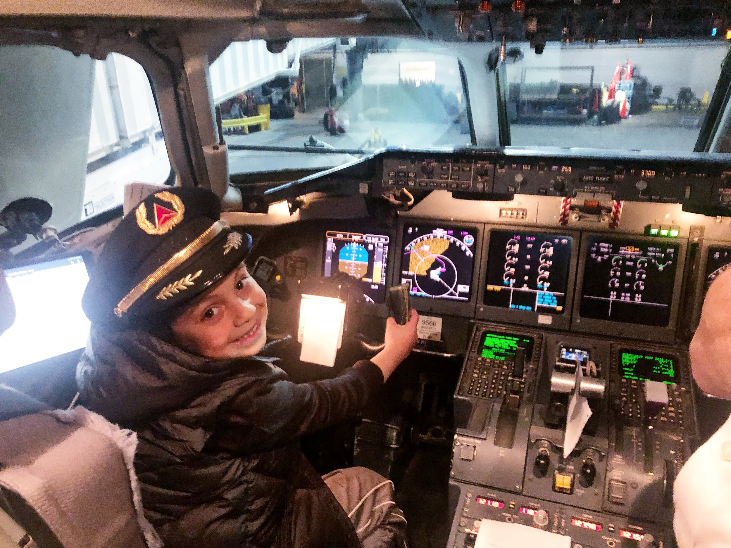 Benny enjoys a tour of the cockpit with a special opportunity to take the Captain's seat.
