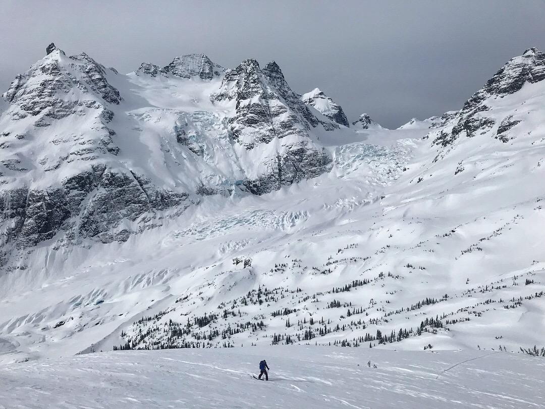 Skinning up Tom George Peak with the steep Polemic Glacier off Hut Peak in the background meeting the Burnie Glacier below.
