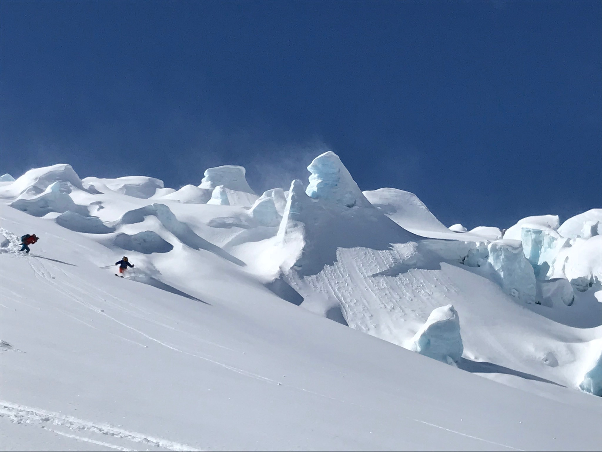 Louis and Joe getting the shot under the seracs of the Loft Glacier