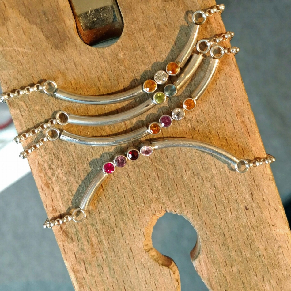 Birthstone necklaces - Repurposed birthstone jewelry using client's stones.