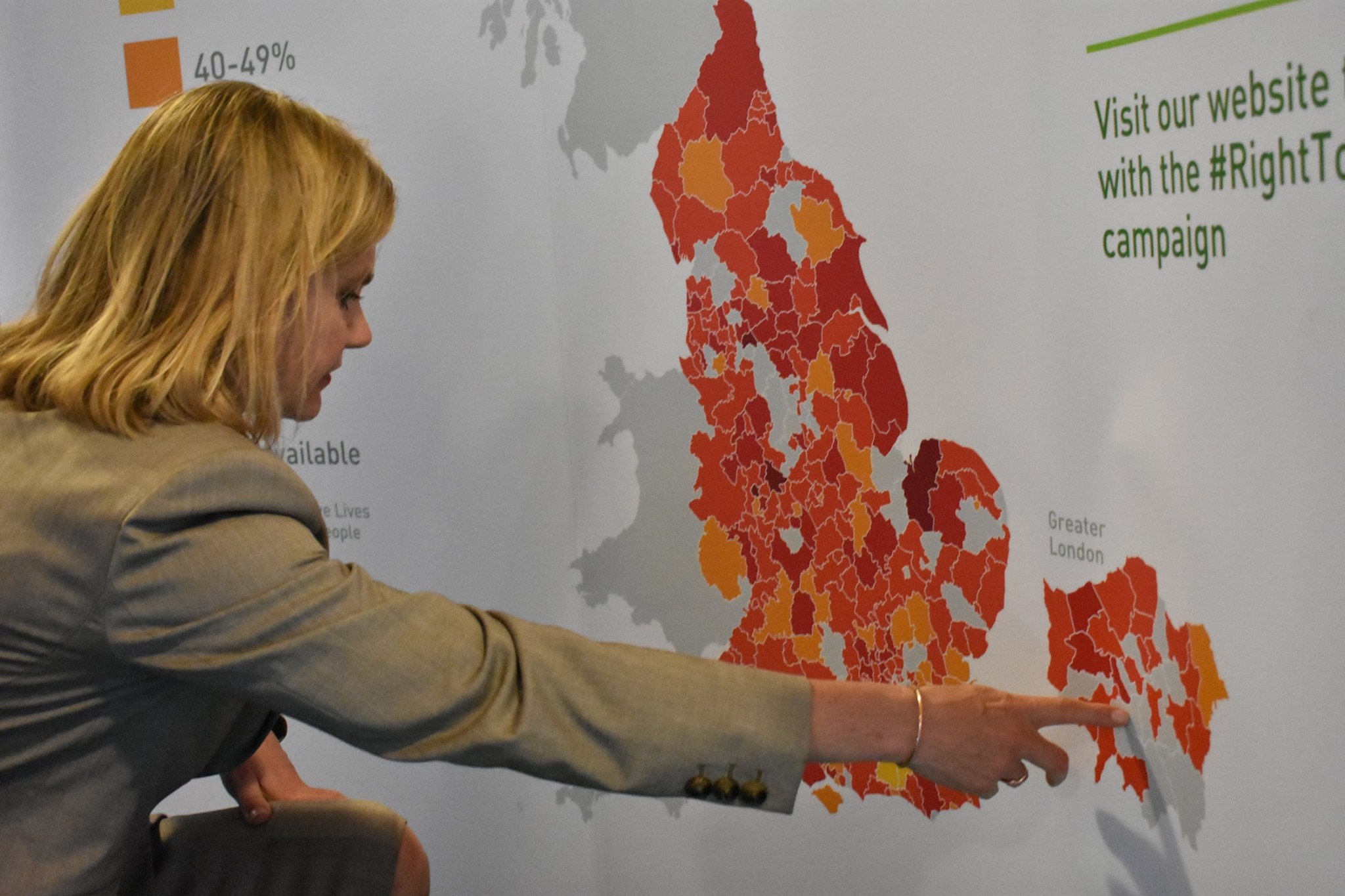 Justine Greening checks out Sport and Recreation Alliance's map on the stand designed by Polimapper (Photo Credit: Sport and Recreation Alliance)