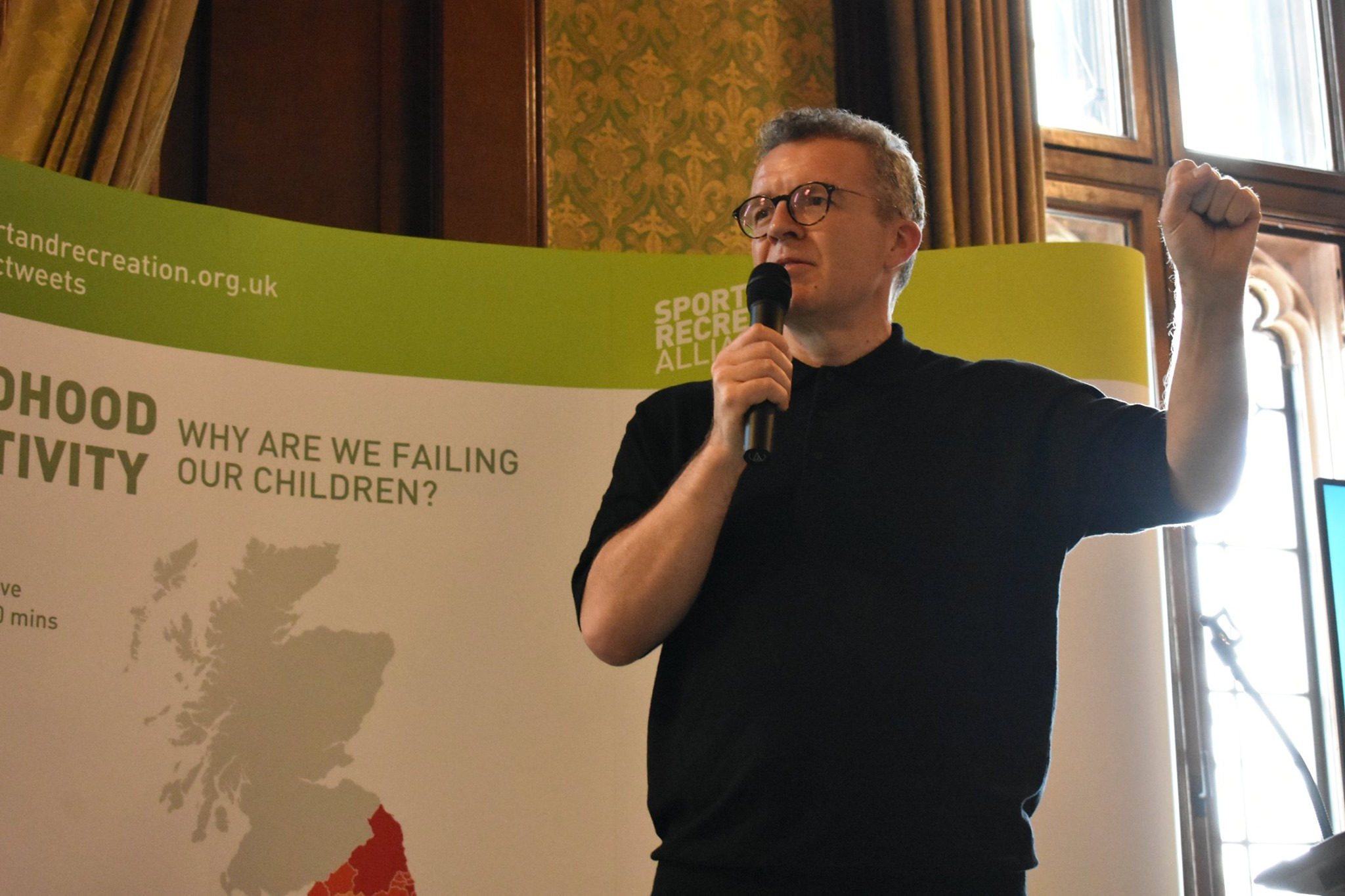 Tom Watson addresses the room in front of the PoliMapper-designed stand backdrop (Photo Credit: Sport and Recreation Alliance)